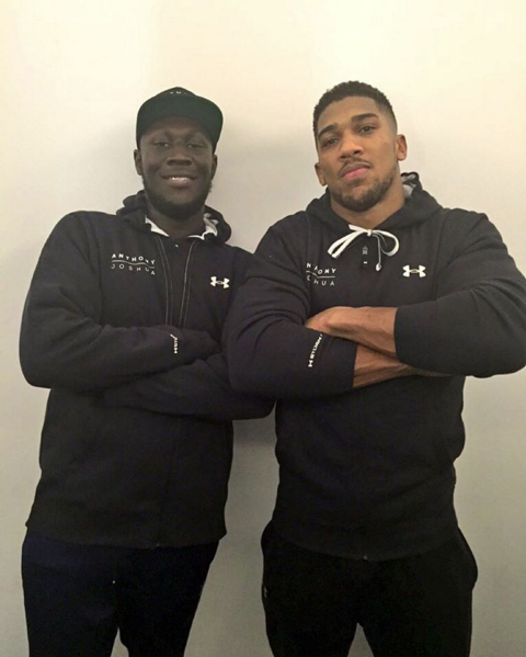 TEAM UK: Stormzy with boxer Anthony Joshua backstage at London's O2 Arena on Saturday (Dec 12)