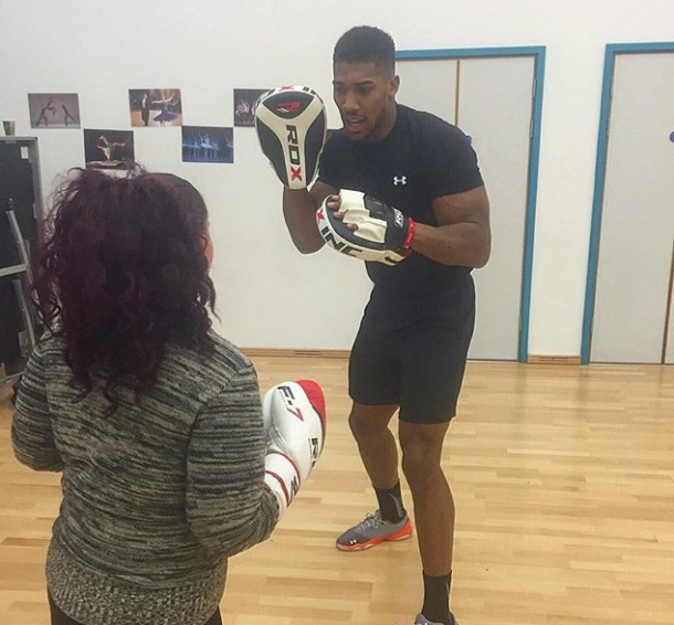 GIVING BACK: Anthony Joshua teaching the group his best moves