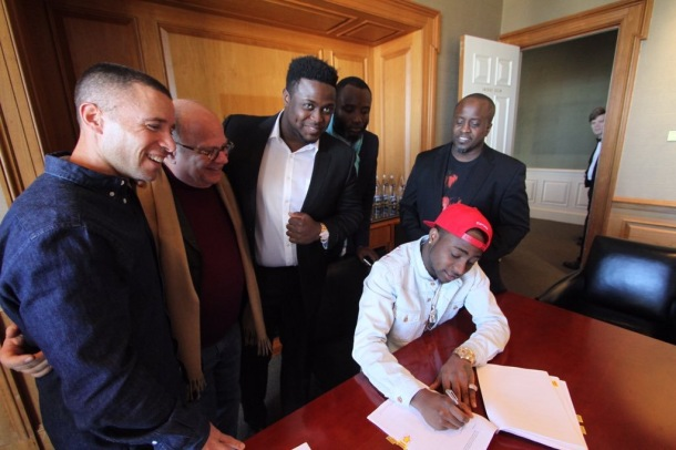 MAKING IT OFFICIAL: Davido signs his record contract in the Sony offices