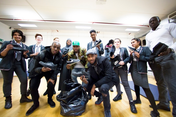 HELPING HAND: The team also visited St Paul's Way school in Bow, where the students had collected shoes for the initiative and met and spoke with Roll Deep rapper and Crep Protect owner, J2K