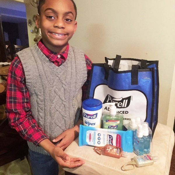 PRAISE FROM THE PRESIDENT: The schoolboy poses with his supplies for Flint