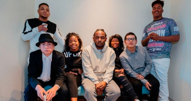 GIVING BACK: Kendrick Lamar with students