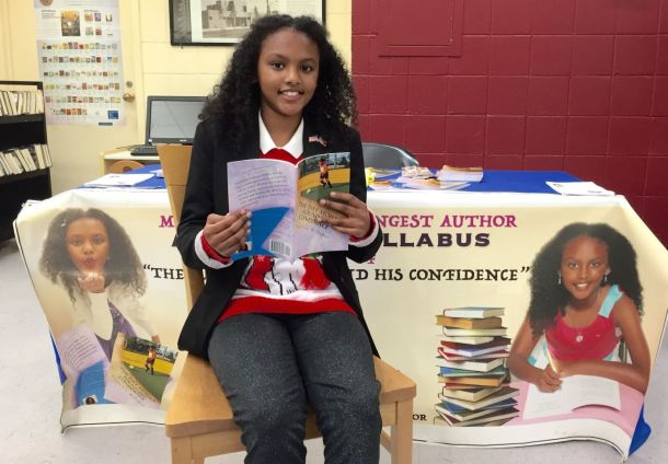 YOUNG AUTHOR: Anaya Lee Willabus with her book, The Day Mohan Found His Confidence