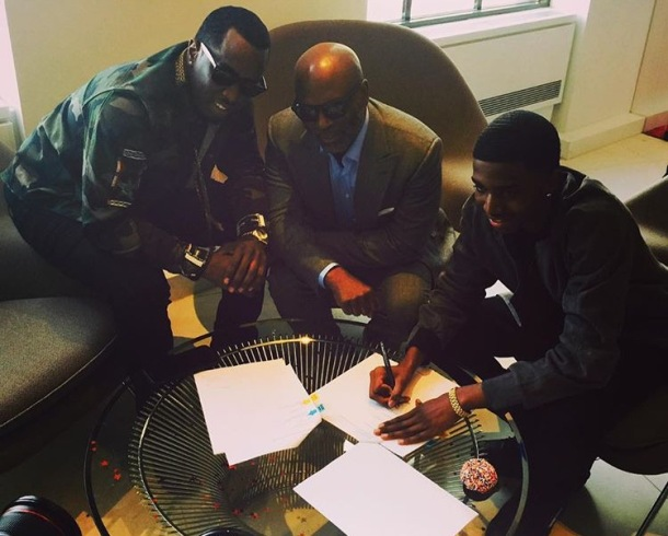 SIGNING ON THE DOTTED LINE: (L-R) P Diddy, LA Reid and Christian