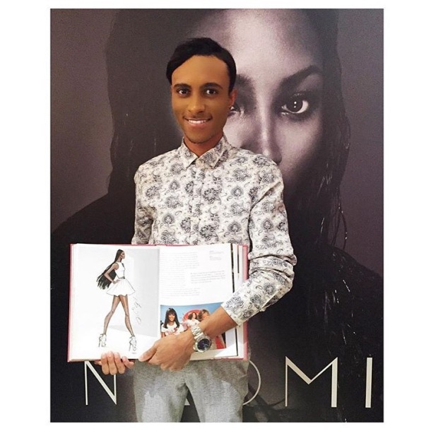 HUGE MOMENT: Hayden poses with a copy of Naomi Campbell's book