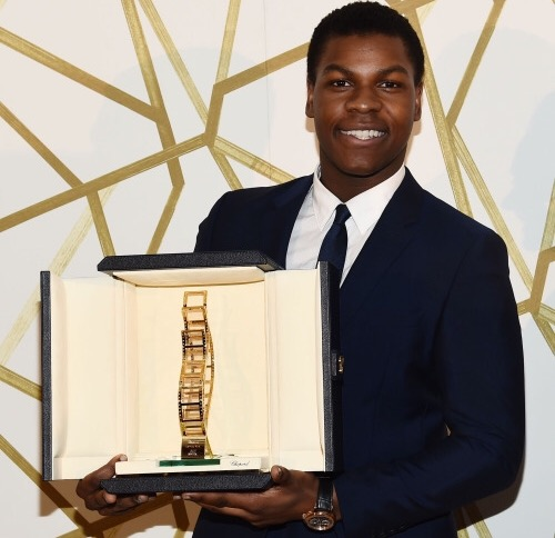 HONOUR: British actor John Boyega collects his Chopard Trophy in Cannes