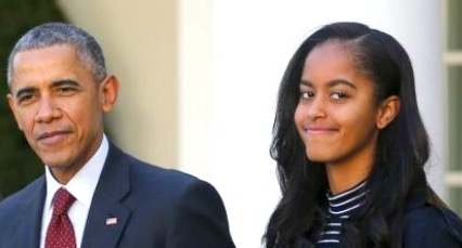 SPREADING HER WINGS: Malia Obama with her father, Barack Obama, President of the United States