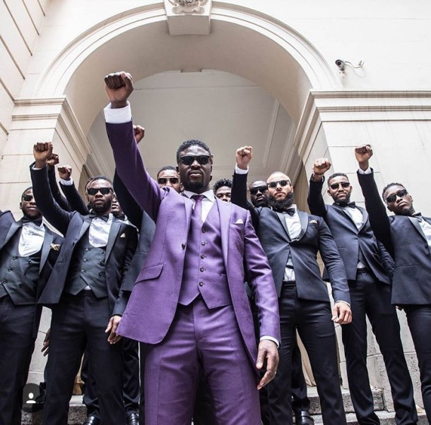STANDING TOGETHER: Groom Karl holds up his fists with his groomsmen