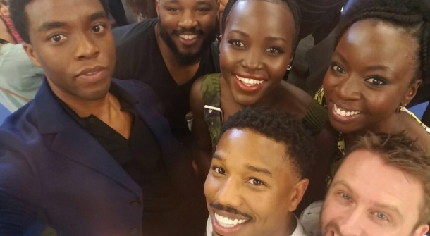 STAR-STUDDED: Lupita Nyong'o poses in a selfie with the cast and crew of Black Panther