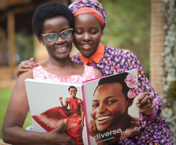 MUMMY'S GIRL: Lupita with her mother and a copy of Diverse Beauty
