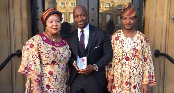 ROYAL APPOINTMENT: Tunde Okewale MBE collects the honour at Buckingham Palace with his family