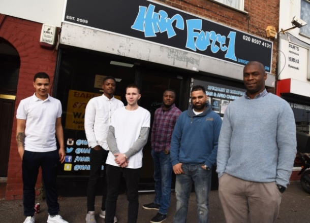 GIVING BACK: Anderson (far right) in front of his east London barbershop, Hair Force 1 [PIC CREDIT: Romford Recorder]