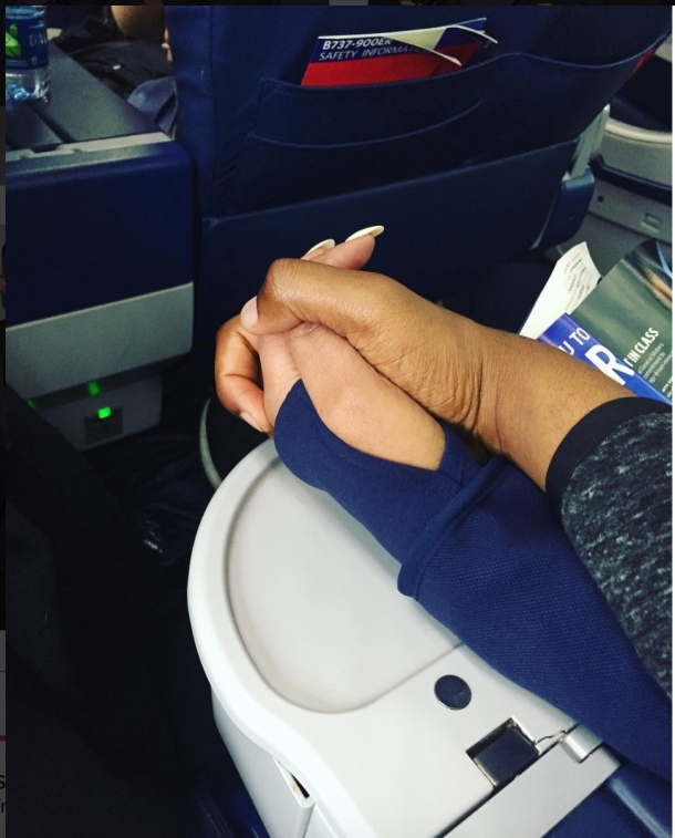 GRATEFUL: Ashley posted this picture of him holding his mother's hand on board a flight back to Atlanta
