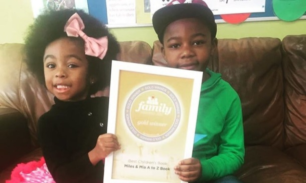 BEST CHILDREN'S BOOK: Miles and Mia with their award