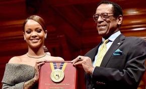 Rihanna collects her Humanitarian of the Year award fromHarvard
