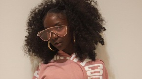 An 11-year-old schoolgirl once bullied about her dark skin makes history as one of the youngest designers at New York Fashion Week